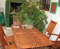 Wooden table at braai area