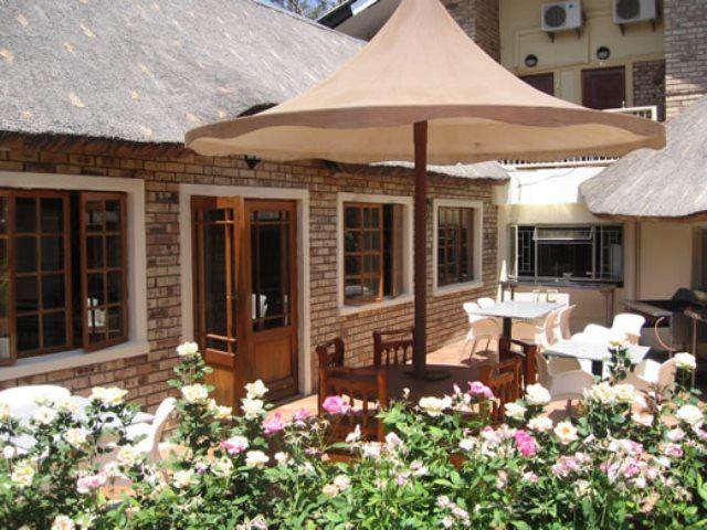 villa de la rosa guest house bloemhof bloemhof. Black Bedroom Furniture Sets. Home Design Ideas