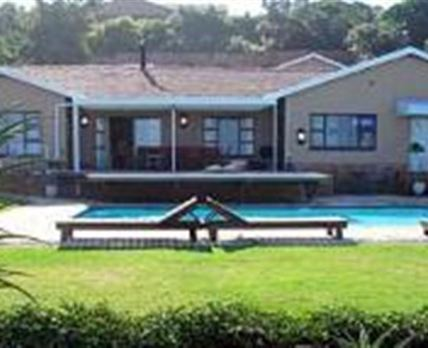 Swimming pool, braai area and deck(the main house is in the background not the guest rooms)