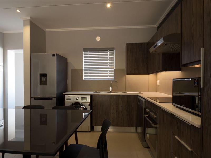 Insignia luxury apartments accommodation in johannesburg for Luxury kitchen johannesburg