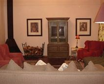 The lounge area - lovely log fire <div>TV with DSTV</div>