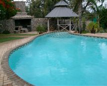 Swimming pool area with braai area
