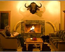 Enjoy a good glace of wine in our downstairs lounge with fire place