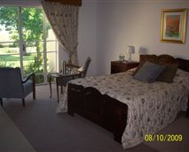 Luxury Double en-suite bedroom with a very comfortable corner  bath and shower, lounge with TV,barfridge & hospitality tray. This beautiful decorated suite with antique furnishing overlooks the garden.