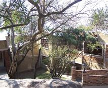 Natural and indigenous bush and trees as well as rocky outcrops surround this private secluded property