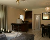 Each apartment has its own living room, kitchen, and dining table.