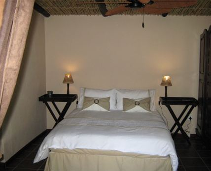 The bedroom is equipped with a ceiling fan and a double bed.  All bedding is supplied.
