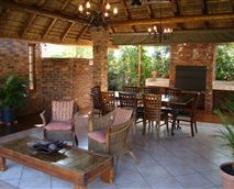Hearty English or healthy breakfasts are served under the thatched lapa.
